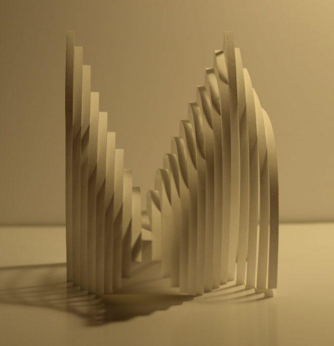 Découpage de papier blanc d'une succesion de bandes aux différentes inclinaisons