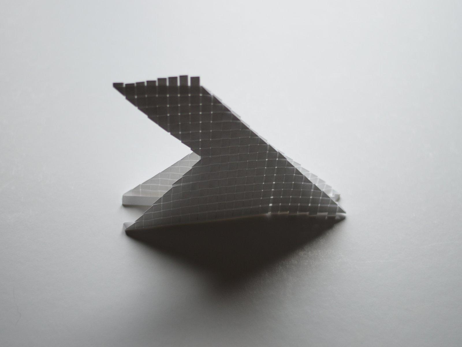 sculpture de papier à contre jour